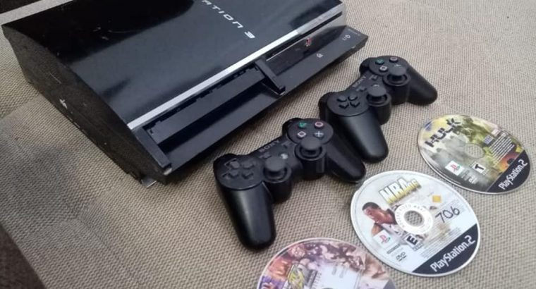 PS3 Pro with 2 controllers and 3 CDs for sale